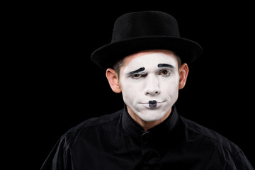 confused mime looking at camera isolated on black