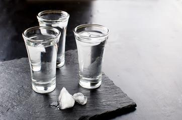 Vodka shots on black table