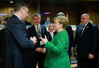 Croatian Prime minister Andrej Plenkovic talks with German Chancellor Angela Merkel during during a High Level Conference on the Sahel in Brussels