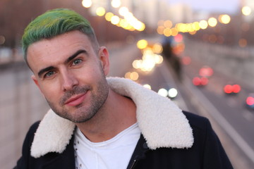 Trendsetter with green hair looking with confidence