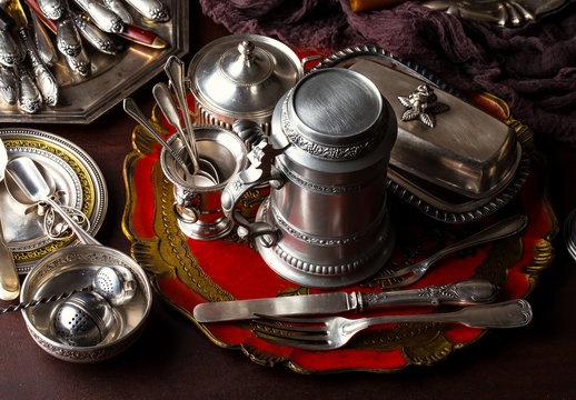Old silver dishes with accessories for the kitchen