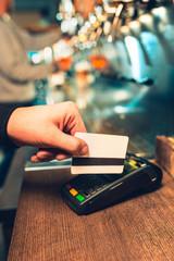 Man using payment terminal