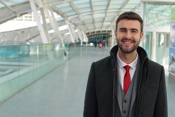 Prosperous elegant businessman smiling isolated