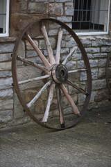 An old cart wheel.