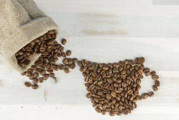 Many coffee beans depicting a coffee cup