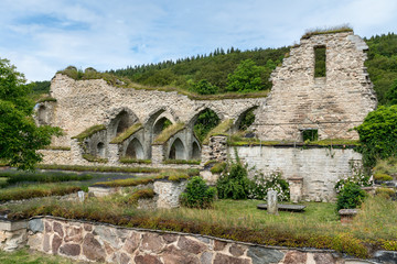 Ruin of monastery from the middle ages with nice garden in the foreground