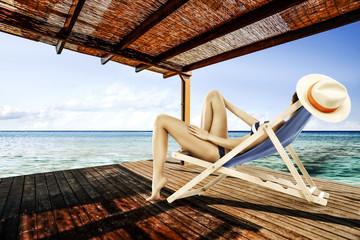 woman in bikini on terrace and summer time