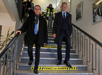 French Finance Minister Le Maire walks with Tavares, Chairman of the Managing Board of PSA Group, ahead of his visit at the Peugeot Citroen production unit of the French carmaker PSA Group in Sausheim