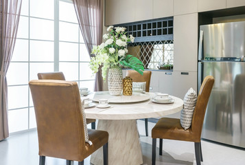 modern ceramic tableware in green color scheme setting on dining table in luxury house.