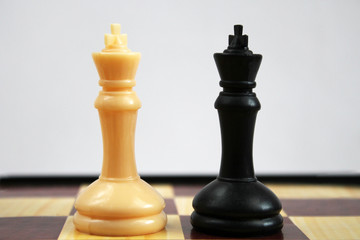 Chess figure, business concept strategy, leadership, team and success. Pair of king chess peaces confronted as opposites.leadership, confidence and imagination concept.