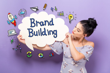 Brand Building with young woman holding a speech bubble