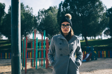 Pretty woman in glasses on playground