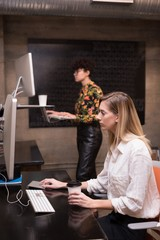 Female executives working on computer