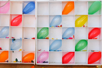 Darts shooting gallery with colorful balloons