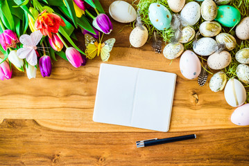 Blank notepad with free copyspace and easter and spring decorations from above