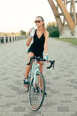 girl smiling beside her bike in the park