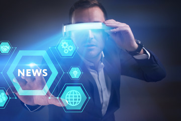 Business, Technology, Internet and network concept. Young businessman working in virtual reality glasses sees the inscription: News
