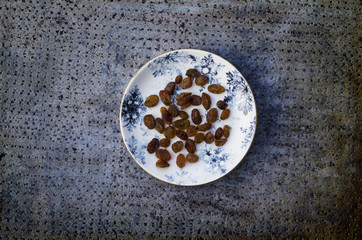 Sultanina raisins on blue background