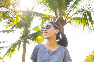 Young woman in park, Bangkok, Thailand