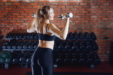 Workout Woman with dumbbell in gym, closeup biceps exercise