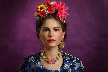 Beautiful young woman with flowers and beads