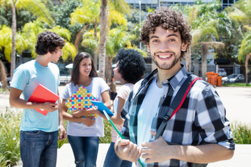 Laughing hipster student with group of friends