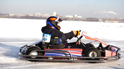 Kart racing on the frozen lake. Winter cart. Riding a go kart in the winter