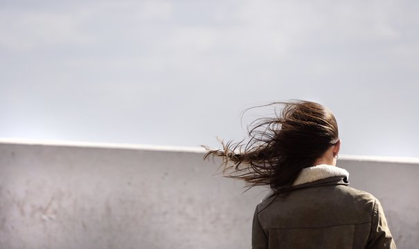 hair flowing in the wind, a woman and a cold day