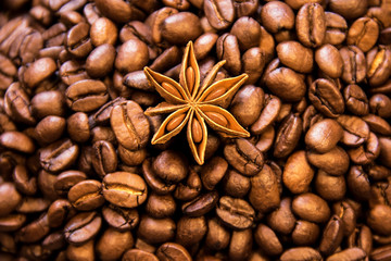 Coffee texture with spice. Roasted coffee beans as background wallpaper. Beautiful arabica real cofee bean illustration for any concept. Gourmet coffee beans macro closeup studio photo.