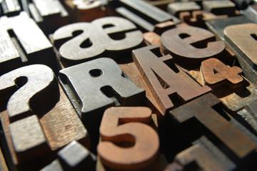 wooden letterpress closeup, various typefaces