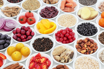 Super food nutrition for a healthy heart high in antioxidants, anthocyanins, fibre, vitamins and minerals with fresh fruit, vegetables, pulses, seeds, nuts, cereals and herbs used in herbal medicine.