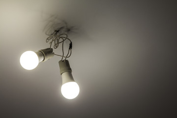 Two white electric bulbs on ceiling