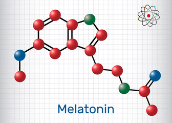 Melatonin molecule, sleep hormone. Atoms are represented as spheres with color: carbon (red), oxygen (blue), nitrogen (green). Molecular model. Sheet of paper in a cage.