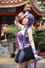 Portrait of asian young woman dancing with purple Chinese dress cosplay with temple