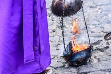 Burning incense, Holy Thursday procession, Antigua, Guatemala