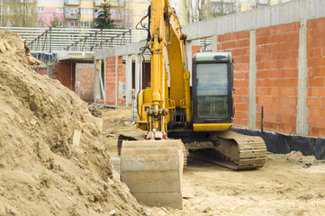 Excavator on the construction site of a new building