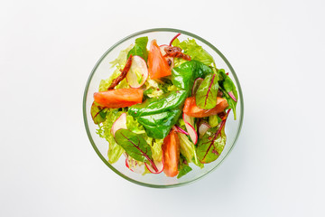 Lenten salad with lettuce, radishes and tomatoes on a white background