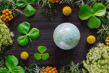 Green Aventurine Sphere with Shamrocks and Mixed Foliage