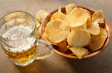 chips and beer on a wooden table