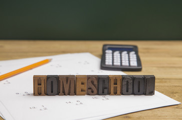 """Home School"" Spelled Out with Homework on the Table"