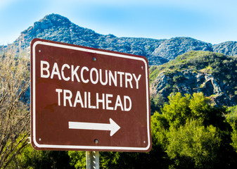 "brown and white sign saying ""Backcountry Trailhead"" in the Santa Monica Mountains of California"