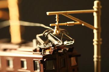 Miniature railroad toy model scene.