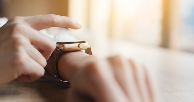Woman use of smart watch at coffee shop