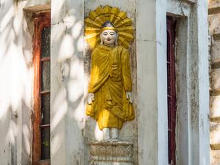 Buddha image on building in Yangon