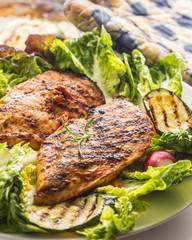 Chicken breast. Grill chicken breast with lettuce salad zucchini and radish