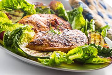 Chicken breast. Grill chicken breast with lettuce salad zucchini and radish