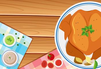 Roasted chicken on wooden board
