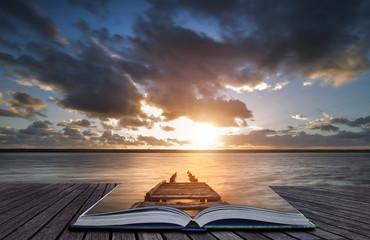 Creative book image of Beautiful vibrant sunset landscape image of Fleet Lagoon in Dorset England Wall mural