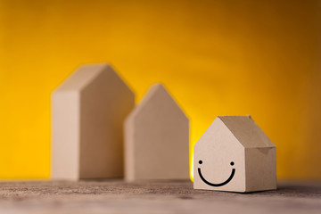 house model paper cardboard on yellow background with free copy space house concept
