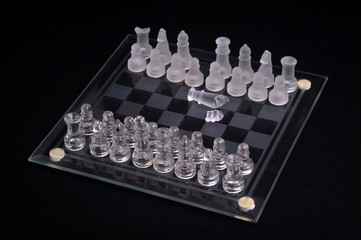 Glass chess set. Intellectual and strategy conceptual. (selective focus)